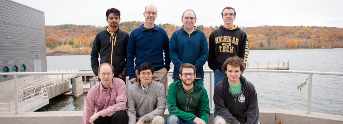 Eight faculty and student researchers outside the Great Lakes Research Center home of the cloud chamber